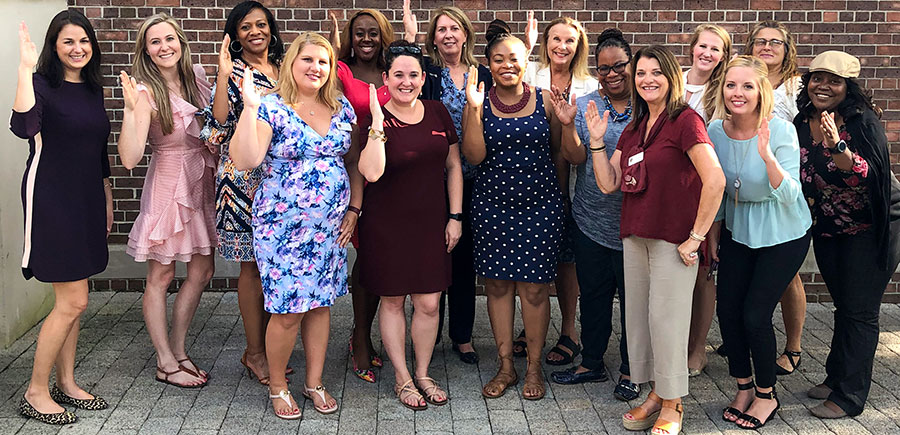 Image featuring members of Women for Florida State University Jacksonville regional group at recent event