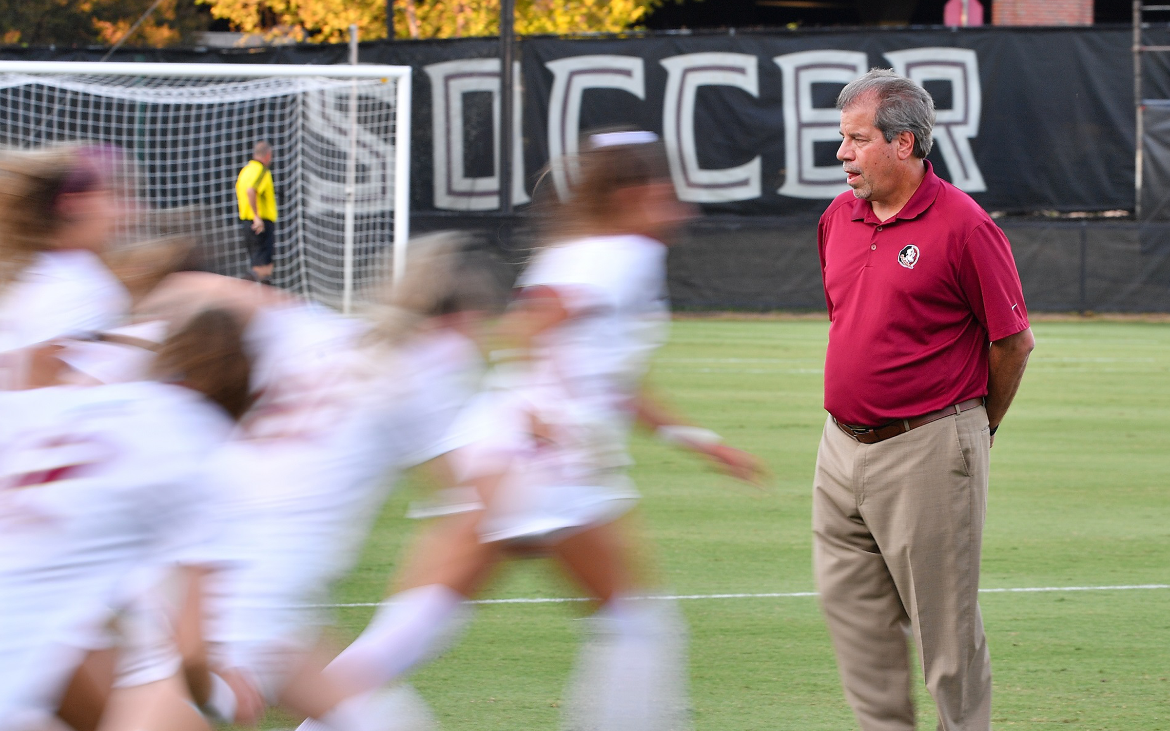 Coach Krikorian with players on a field