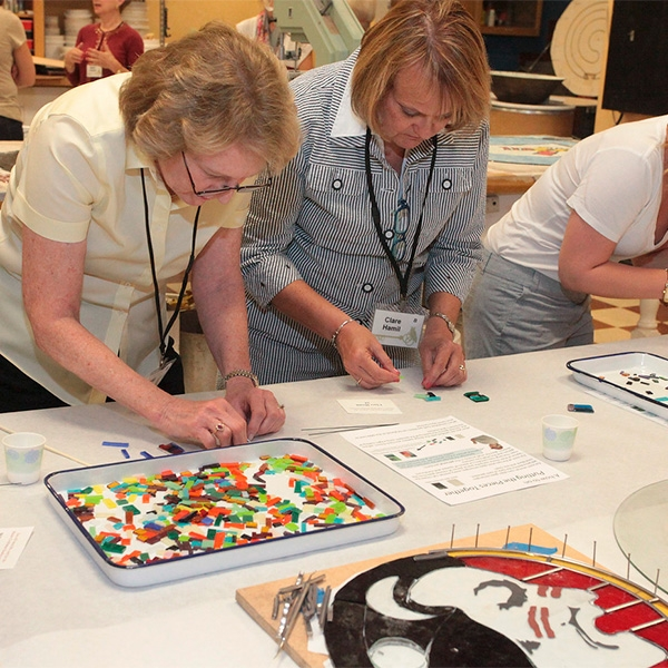Women for FSU making fused glass artwork at Master Craftsman